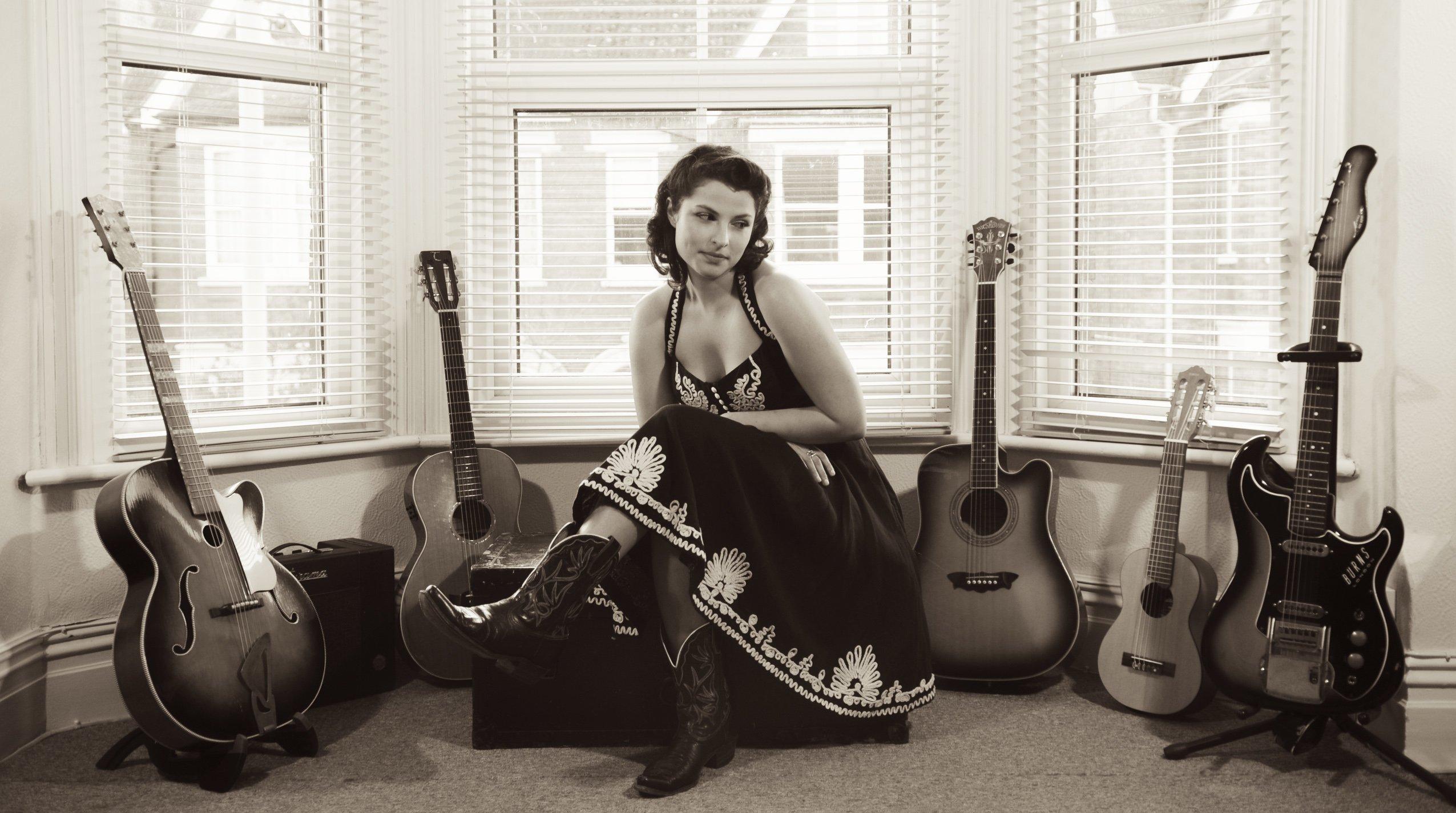 Danni Nicholls with Guitars