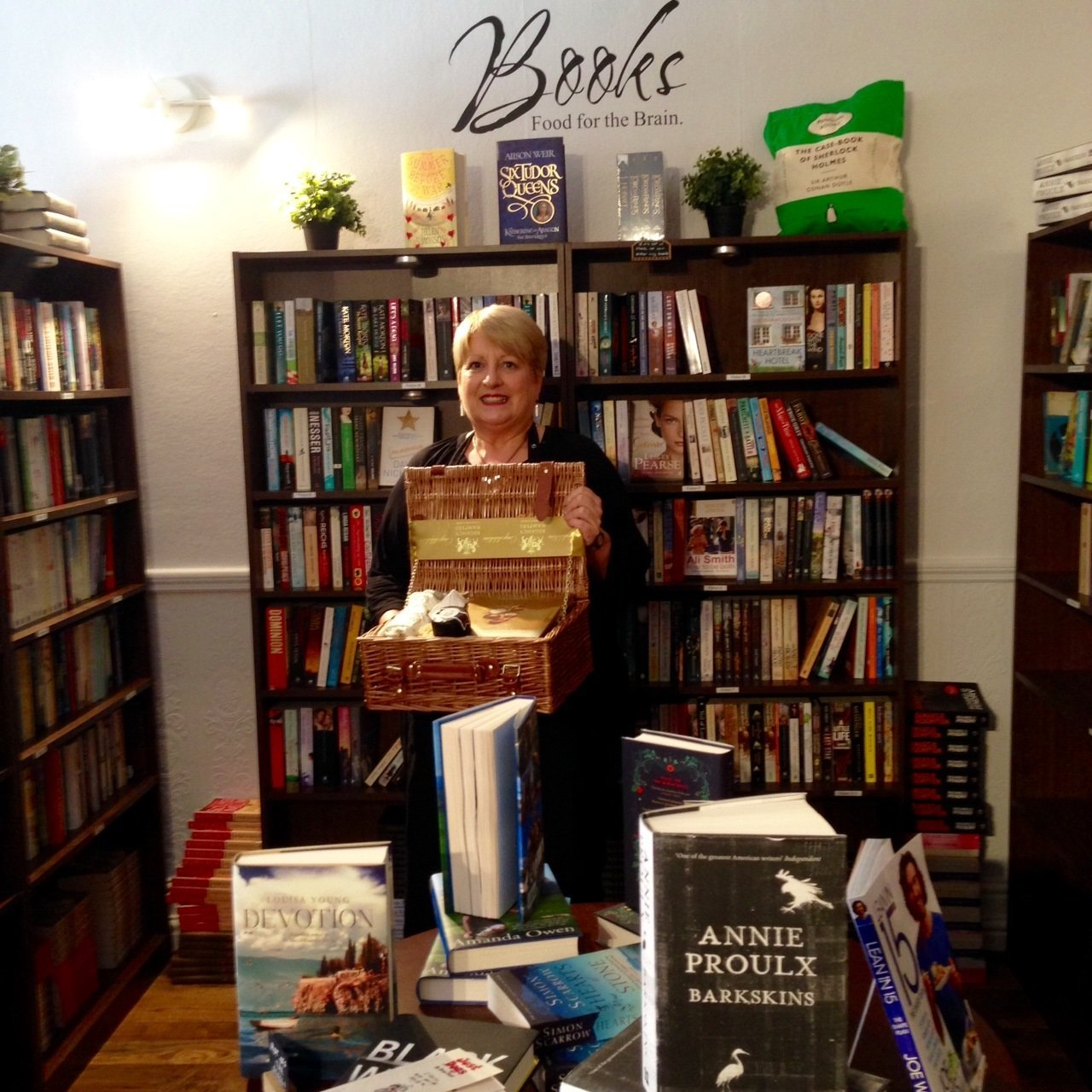 Octavo founder Hazel Cushion with prize hamper after winning Bookshop of the Month