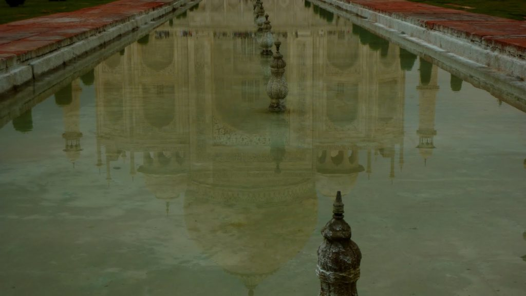The Taj Mahal reflected in a pool of water in Agra, India, courtesy of Roxanne Krystalli
